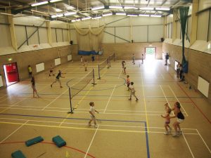 The sports hall being used a fun games of badminton (c) Burwell Sports Centre