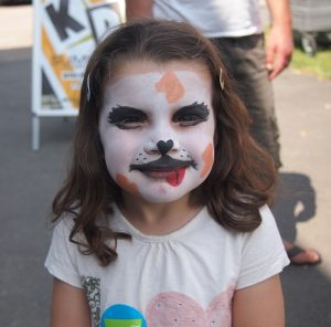 A young girl very proudly displays her 'dog' painted face (c) Burwell Sports Centre